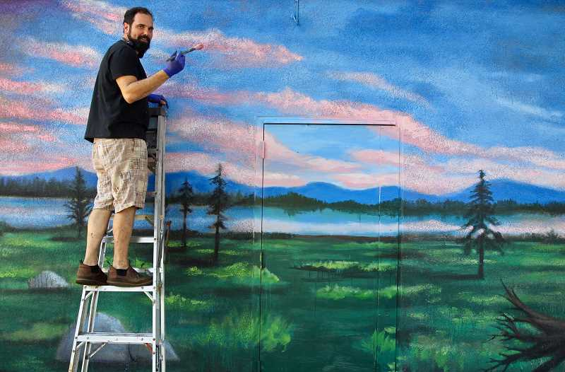COURTESY PHOTO - Joe Riso is adding details of birds, bees and mushrooms to the Milwaukie mural.