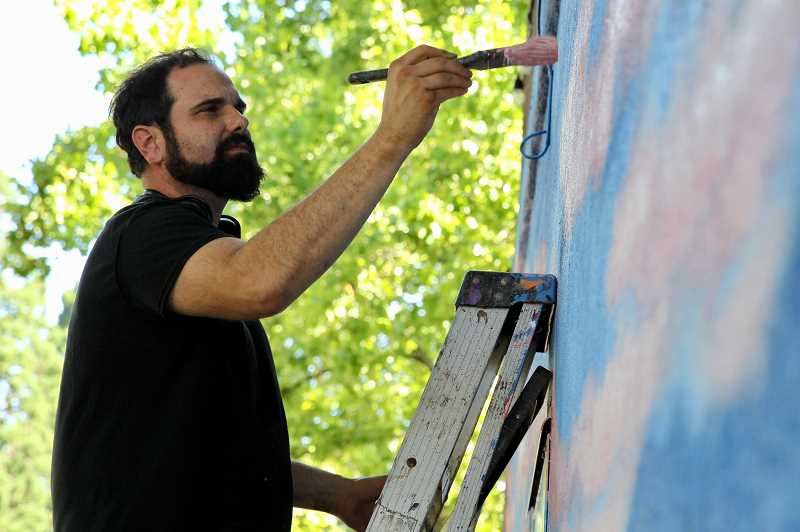 COURTESY PHOTO - Joe Riso is painting a sunrise view of Mount Hood on a mural in downtown Milwaukie.