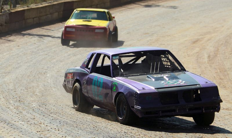 PMG PHOTO: MILES VANCE - Joey Tardio of Forest Grove (front, shown here on July 12) and Warren's Terry King were back to battle in the Sportsman Division main event  during the Columbia County Racing Association's Saturday, July 18, event at the River City Speedway in St. Helens.