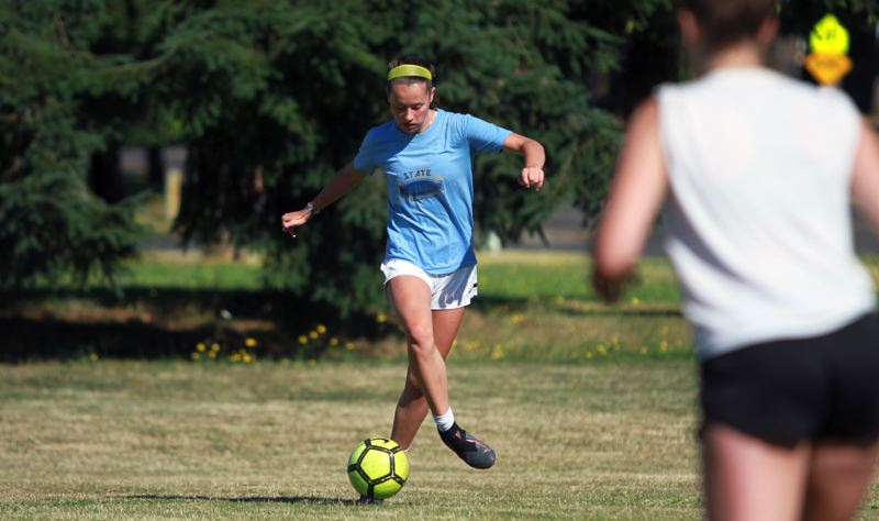 PMG PHOTO: MILES VANCE - Scappoose's Sydney Hanke, an incoming junior, goes through skill workouts at Scappoose High School on Tuesday, July 21.