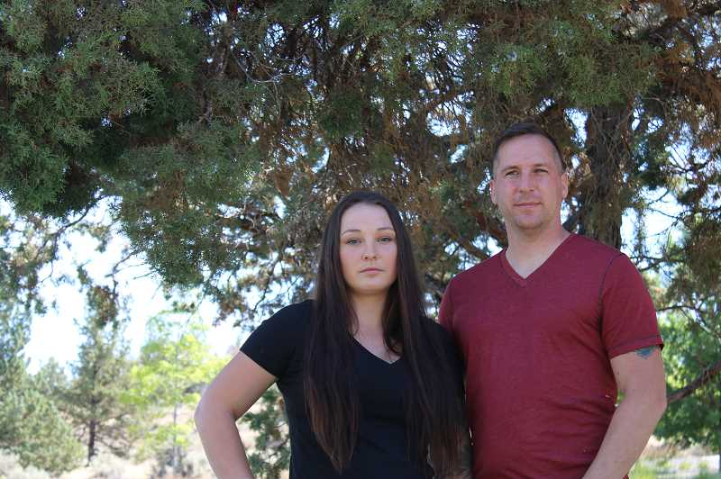 TERESA JACKSON/MADRAS PIONEER - Cassandra and Bryan Ruwaldt went to the Metolius City Council in March asking for a train that had been made by the man who sexually abused her to be removed from a display at City Hall. When the council voted to put the train back, it started a firestorm of controversy.