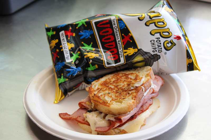 TERESA JACKSON/MADRAS PIONEER - A Frenchman sandwich plated up with Voodoo chips at the Wandering Chef food truck in Madras.