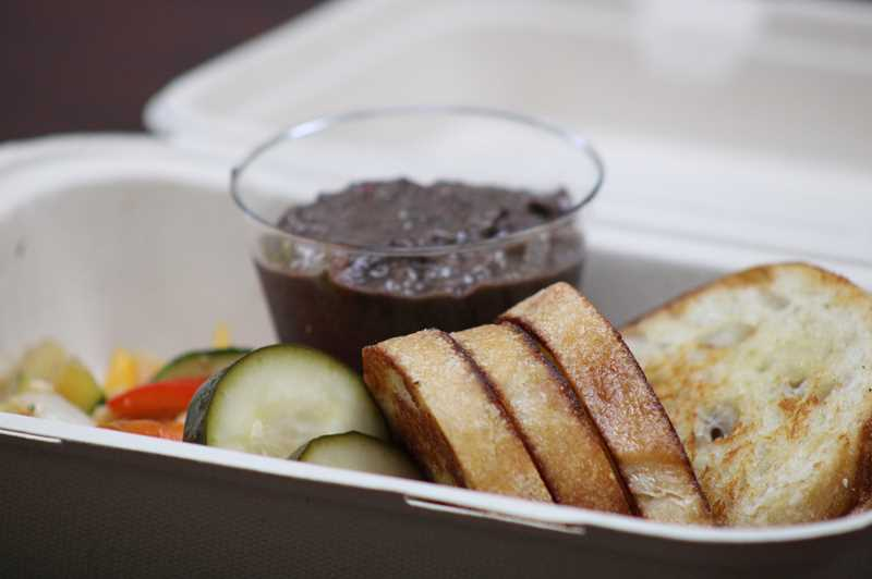 TERESA JACKSON/MADRAS PIONEER - Bean dip with roasted and pickled vegetables and grilled bread at the Wandering Chef food truck in Madras.