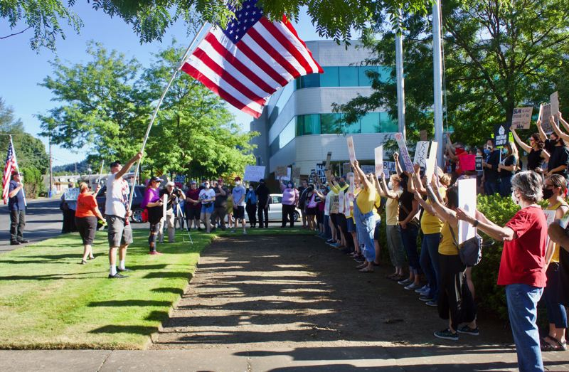 PMG PHOTO: CHRISTOPHER KEIZUR - Two groups of protestors came together in a clash over the flying of the Black Lives Matter Flag at Gresham City Hall.