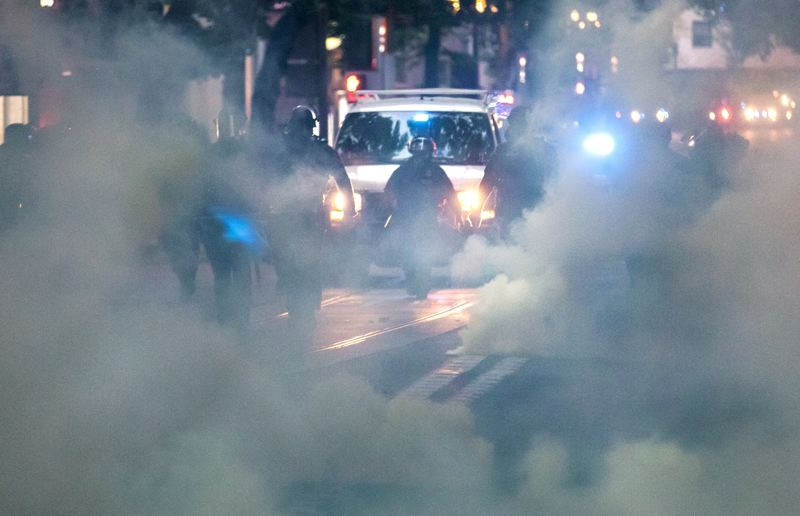 PMG PHOTO: JONATHAN HOUSE - Portland Police Bureau officers have used CS gas, commonly called tear gas, on downtown protesters during multiple days of protests, typically after warnings that cited attacks on police.