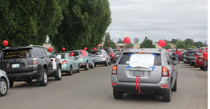 PMG PHOTO: JUSTIN MUCH - Educators gather at Lord HIgh School/MacLaren Youth Correctional Facility for a rally against beginning the school year with any type of in-person learning. The July 21 gathering proceeded into a vehicular rally/parade through the streets of Woodburn.