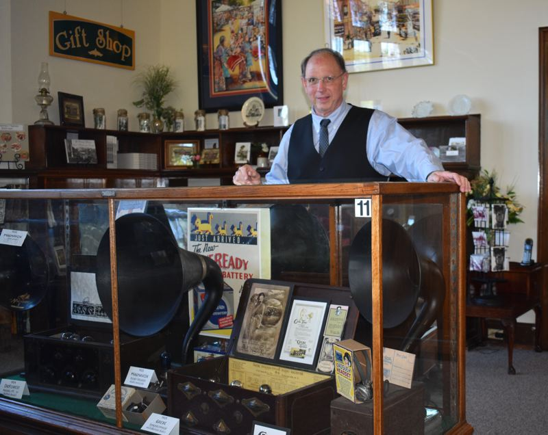 PMG PHOTO: TERESA CARSON - Mark Moore, the new director of the Gresham History Museum, shows off part of a new exhibit on the old days of radio in Gresham.