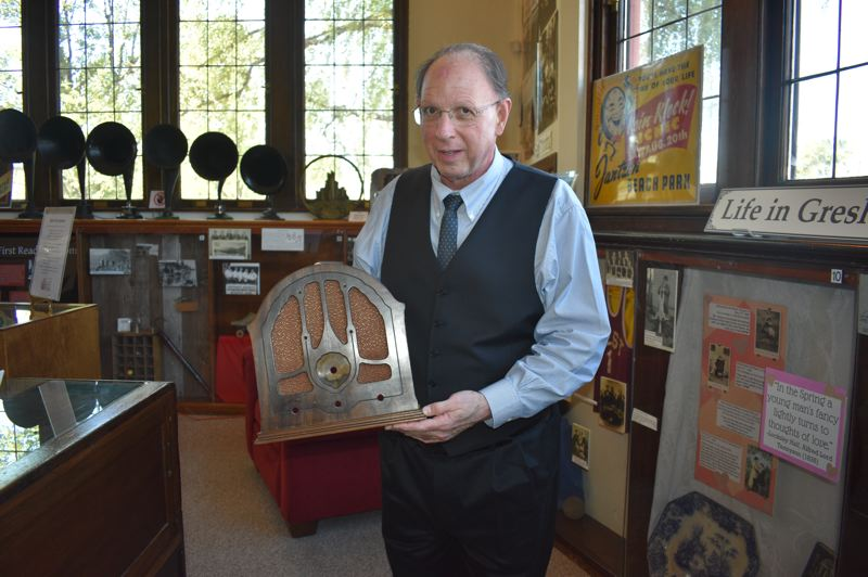 PMG PHOTO: TERESA CARSON - Moore explains some modern uses for a beautiful old cathedral radio from his personal collection.