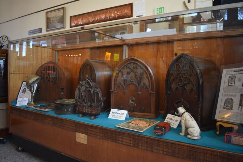 PMG PHOTO: TERESA CARSON - Some elaborately decorated cathedral radios grace a museum case.