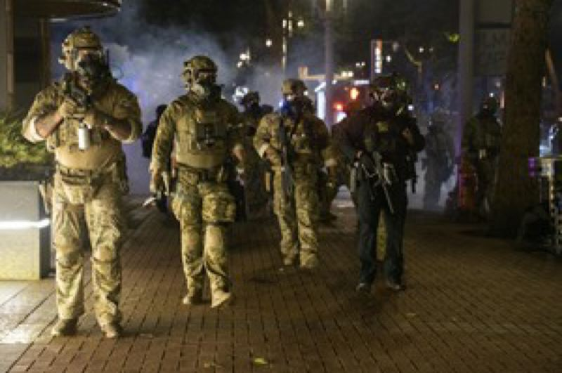 PMG FILE PHOTO - Federal officers at a recent protest in downtown Portland.