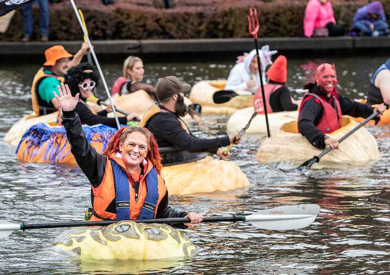 PMG FILE PHOTO - Each year, the West Coast Giant Pumpkin Regatta draws thousands of spectators to The Lake at the Commons in Tualatin.