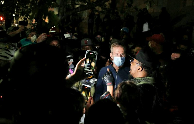 PMG PHOTO: JONATHAN HOUSE - Mayor Ted Wheeler wading into an angry crowd on Wednesday and listening to protesters was a good first step. Now it has to happen regularly, with other city leaders taking part, at a venue at which protesters can actually be heard.
