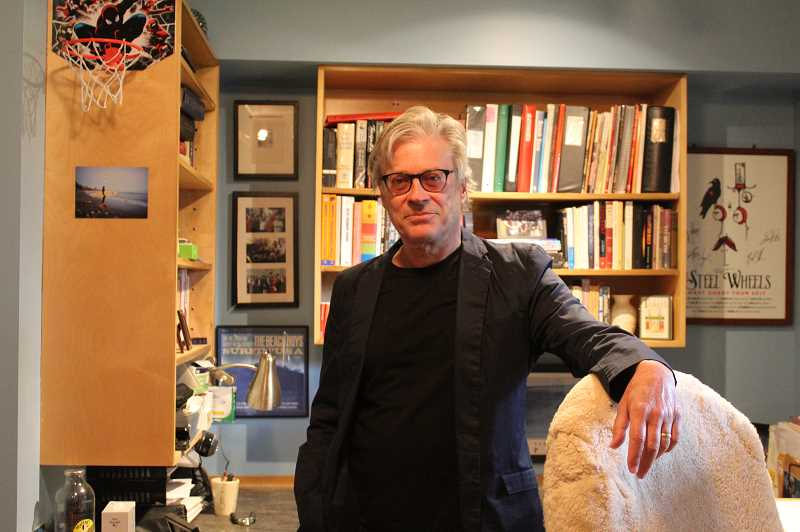 PMG PHOTO: COURTNEY VAUGHN - Michael Tevlin at his home office in Southwest Portland. Tevlin recently published his first book, 'Sockeye,' in March through Black Rose Writing.