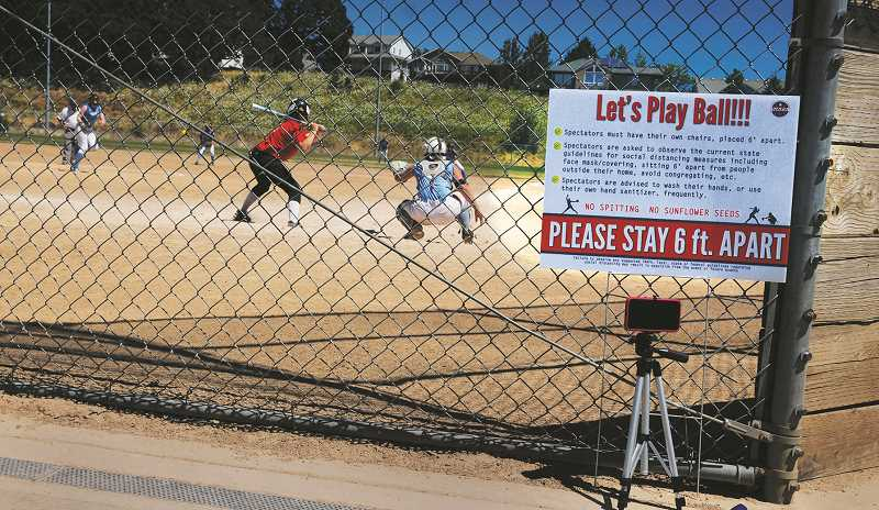 PMG PHOTO: GARY ALLEN - CPRD officials say there are taking proper precautions while allowing play at its softball complexes in Newberg.