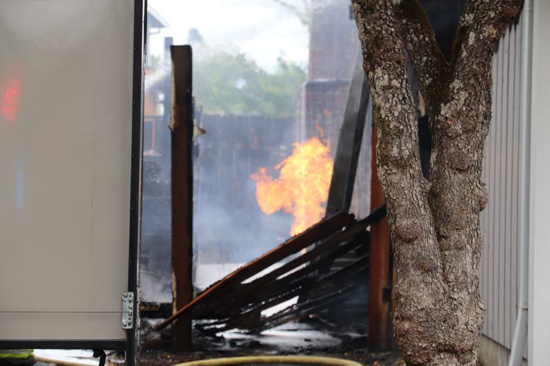 COURTESY PHOTO: HILLSBORO FIRE & RESCUE - A fire between homes in the 900 block of Northeast Baldwin Street in Hillsboro ignited a gas line Friday, July 24.