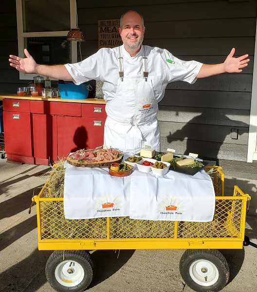 COURTESY PHOTO - On his 5-acre Oregon City-area farm, co-owner Jim Wilburn welcomes visitors with cheese and charcuterie platters.