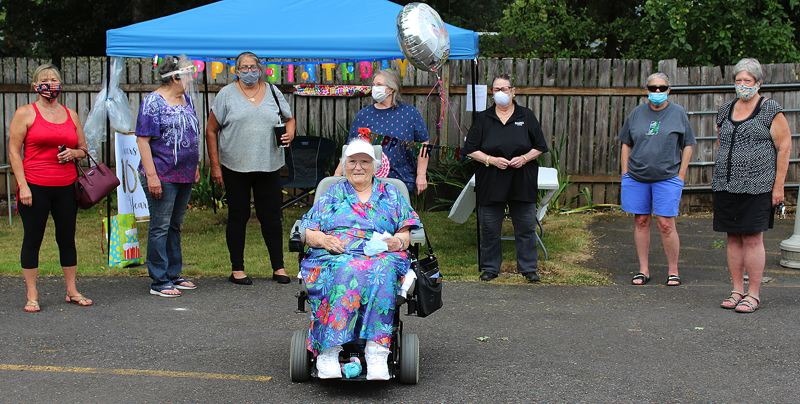 COURTESY PHOTO: ALTA LYNCH - Scappoose resident Alice Whitley (center) was surrounded by family, friends and supporters when she celebrated her 100th birthday on Wednesday, July 22, at Columbia Care Center.