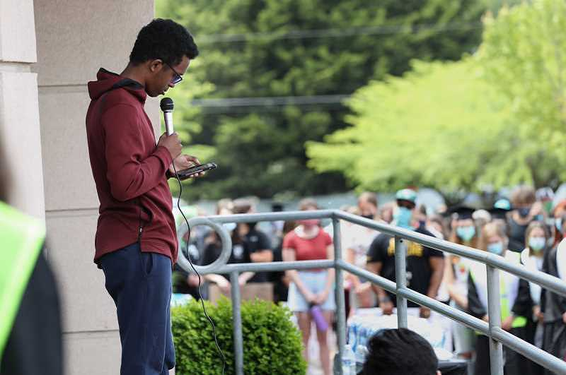 PMG PHOTO: JAIME VALDEZ - During a June protest at Tualatin High School, Abdi Mohamoud reads the names of people killed by police.