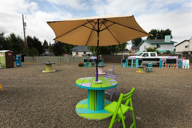 PMG PHOTO: JAIME VALDEZ - Painted tables and chairs at a new 'pop-up plaza' located at North 12th Avenue and Adair Street in Cornelius.