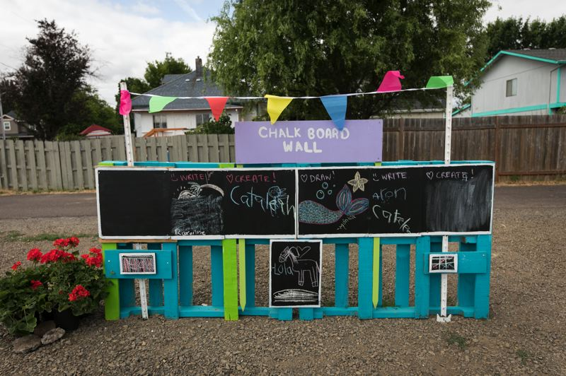 PMG PHOTO: JAIME VALDEZ - Chalk boards are open for public use at a new 'pop-up plaza' in Cornelius.