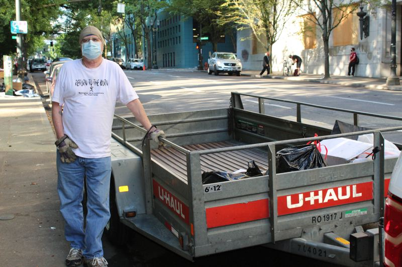 Trash collectors tidy up after nightly Portland protests