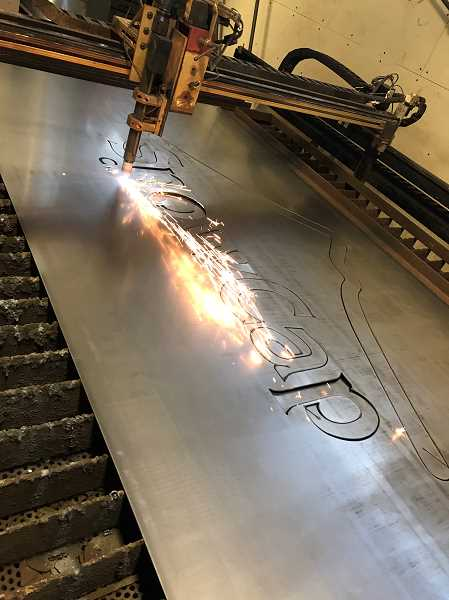 COURTESY PHOTO - A CNC plasma cutter at Clackamas Community College cuts out the lettering of the sign.