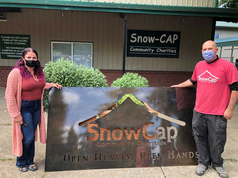 COURTESY PHOTO -  Jessica Jones (left) and Jeremy Wilebski at SnowCap Community Charities.
