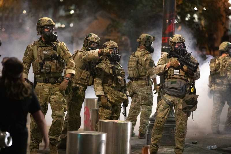 PMG PHOTO: JONATHAN HOUSE - Federal officers patrol downtown Portland after pushing protesters back from the U.S. Courthouse on Monday, July 20.