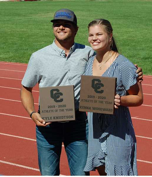 RAMONA MCCALLISTER - Crook County High School Class of 2020 members Kyle Knudtson, left, and Kenna Woodward were named the male and female athletes of the year by the Crook County High School Booster Club at a July 17 ceremony at Ward Rhoden Stadium. Woodward was a track and volleyball standout while Knudtson was a state champion wrestler and outstanding football and baseball player.