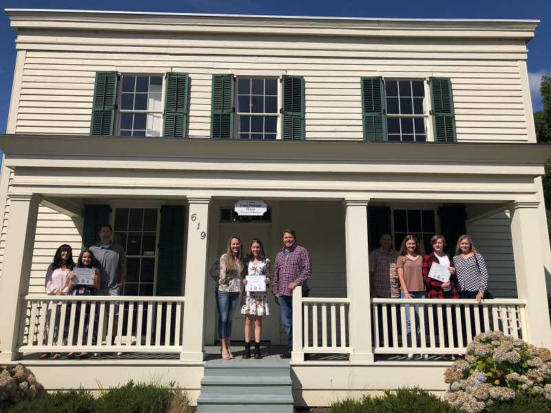 COURTESY PHOTO - Poetry winners in Preserve Our Past contest join their families at the historic Ermatinger House.