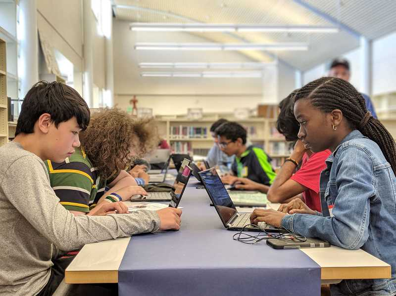 PMG FILE PHOTO - Students in Beaverton work on computer coding at a school library in 2017. The Beaverton Education Foundation aims to help students in need continue connectivity at home during the coronavirus pandemic.