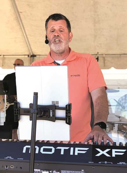 PHOTO BY MISSY MILLER - Tim Friesen works the keyboards during Molalla Nazarene's first outdoor service on Sunday.