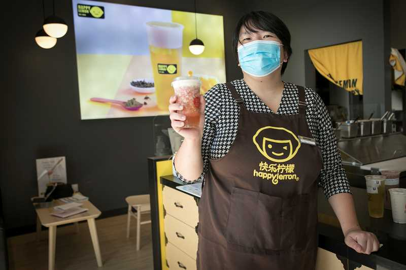 PMG PHOTO: JAIME VALDEZ - Tao Huang owns the franchise Happy Lemon Tea Shop in Bridgeport Village.
