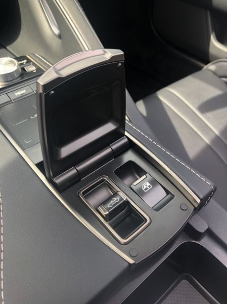 PMG PHOTO: JEFF ZURSCHMEIDE - Once you find it, the hidden switch makes it easy to raise and lower the convertible top of the 2021 Lexus LC500 quickly.