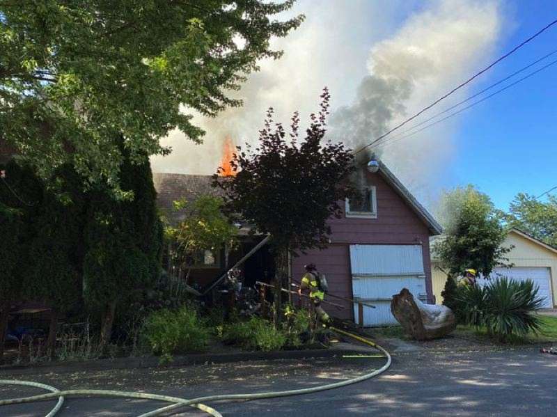 COURTESY PHOTO: CORNELIUS FIRE DEPARTMENT - Firefighters respond to a fire in a Cornelius home Wednesday morning, July 29.
