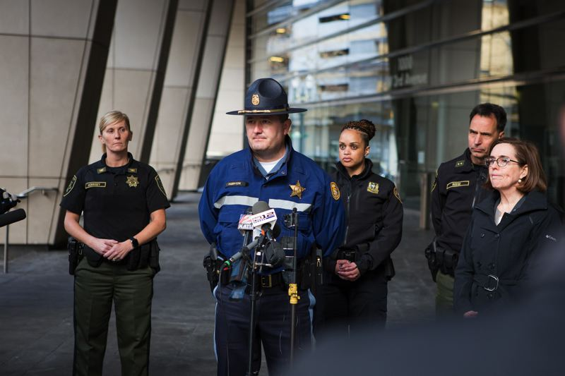 PMG FILE PHOTO - Oregon State Police Superintendent Travis Hampton stood in 2018 with Gov. Kate Brown and Portland-area law enforcement outside the federal courthouse in downtown Portland.