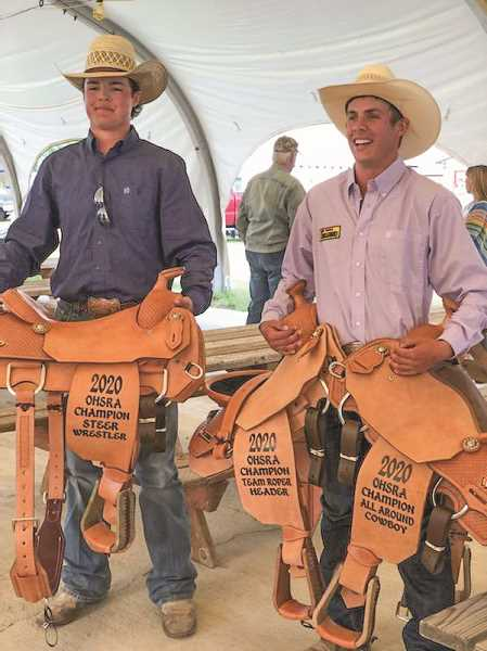 COURTESY PHOTO  - Cord Gomes, left, and Coy Aldrich with saddles won as state champs. The duo also placed in the national high school rodeo in Oklahoma.