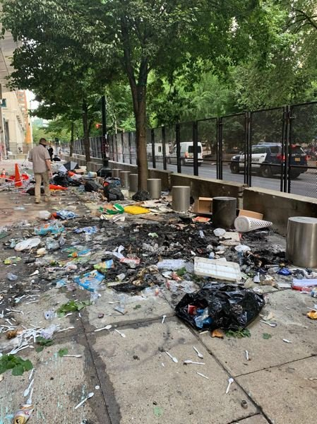 COURTESY PHOTO: PPB - Damage and trash left by nightly protests litters the sidewalk in front of the Mark O. Hatfield U.S. Courthouse in downtown Portland.