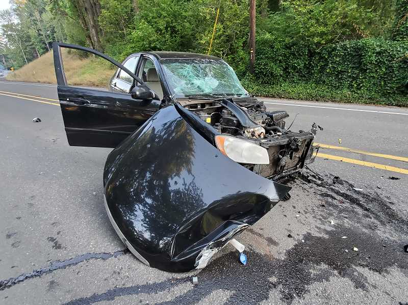 COURTESY PHOTO - Clackamas County Sheriff's Office said Kurtiss Orcutt, 51, of Milwaukie, slammed into a Ford F-550, which lost control and hit this Acura driven by a Sandy woman who died.