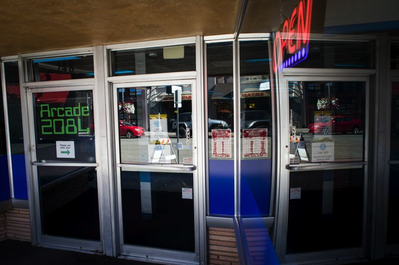 PMG PHOTO: JAIME VALDEZ - An 'open' sign flashes in the window of Hillsboro's new 80s-themed Arcade 2084, which opened in July.