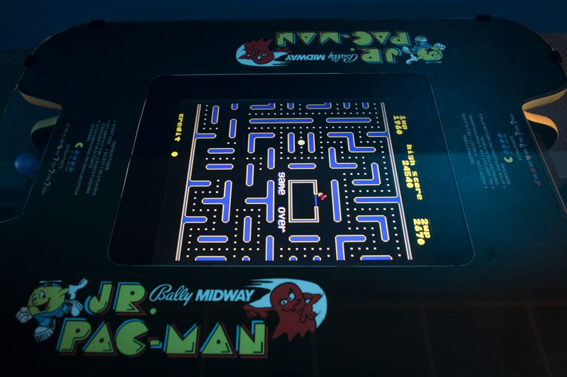PMG PHOTO: JAIME VALDEZ - An original Jr. Pac-man arcade game at Hillsboro's new 80s-themed Arcade 2084.