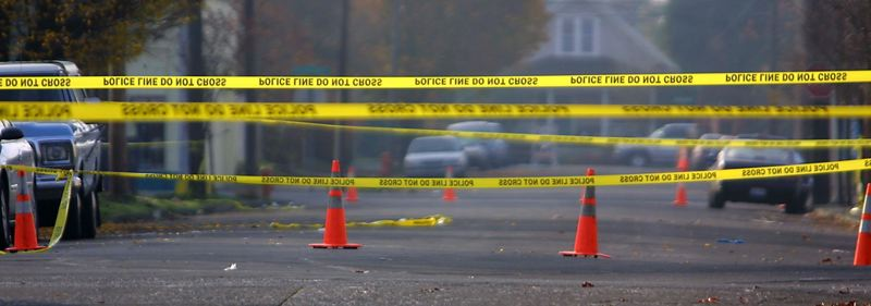 FILE - Police tape marks the crime scene of a triple shooting at 5706 North Mississippi in Portland in 2002.