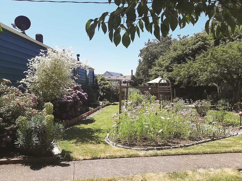 Another look at the Yard of the Month honoree by the Canby Garden Club.