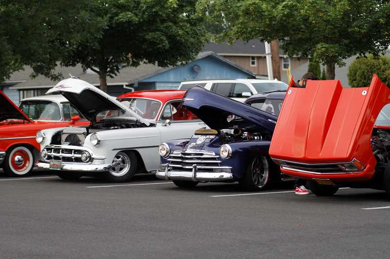 PMG PHOTO: WADE EVANSON - More than 30 cars can be found at the Forest Grove Cruise-In Friday night, July 31, at the Walmart in Cornelius.