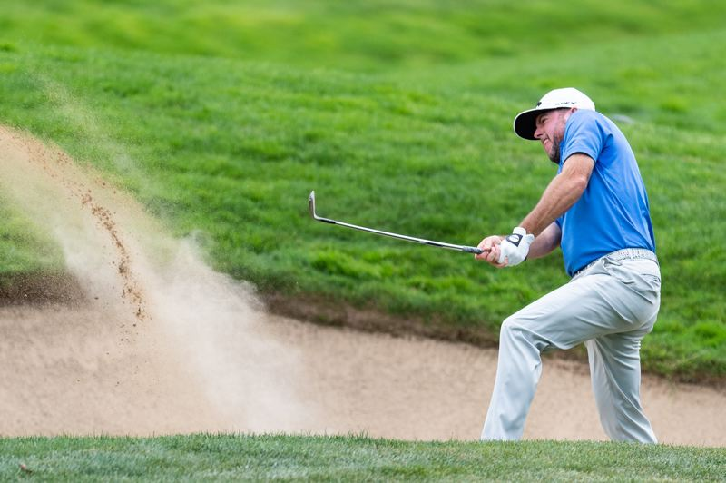 PMG FILE PHOTO - Robert Garrigus hits out of a sand bunker during the first round of the WinCo Foods Portland Open at the Pumpkin Ridge Golf Club last August.