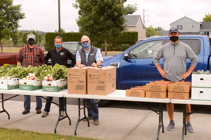 COURTESY PHOTO: JAMES MORRIS - Left to right: Rotary members Tim Rippe, Mitch Taylor and Pete Truax deliver produce to the Forest Grove High School Food Bank.