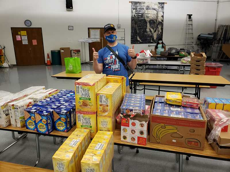 COURTESY PHOTO: MITCH TAYLOR - Rotarian Kevin Noreen volunteering at the Neil Armstrong Food Bank. The Neil Armstrong Food Bank serves approximately 100 families every week.