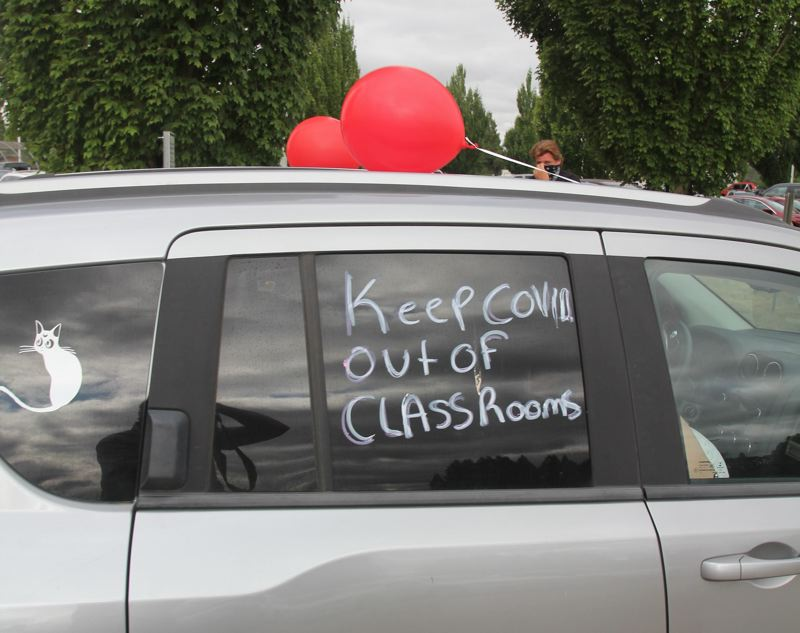 PMG PHOTO: JUSTIN MUCH - Teachers rally in Woodburn on the issue of COVID-19 safety last month.