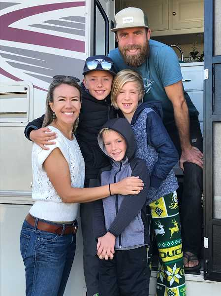 PHOTO COURTESY OF JACOB AND KYLA SALMOND  - The Salmond family pauses for a photo in front of their new RV. Pictured are parents Kyla and Jacob, and children Elias, Judah and Asher.