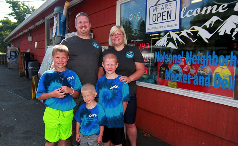 PMG PHOTO: MILES VANCE - The Nelsons (clockwise from top) — Brandon, Kymberly, Bowen, Lawken and Kamden — have gone through a tumultuous but successful first year as owners of Nelson's Neighborhood Market and Deli in Scappoose.